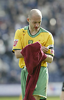Photo: Aidan Ellis.<br /> Preston North End v Norwich City. Coca Cola Championship. 08/04/2006.<br /> Norwich Captain Craig Fleming with a bloody nose