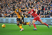Hull City midfielder Moses Odubajo and Hull City midfielder Ahmed Elmohamady beat George Friend of Middlesbrough FC to the ball during the Sky Bet Championship match between Hull City and Middlesbrough at the KC Stadium, Kingston upon Hull, England on 7 November 2015. Photo by Ian Lyall.