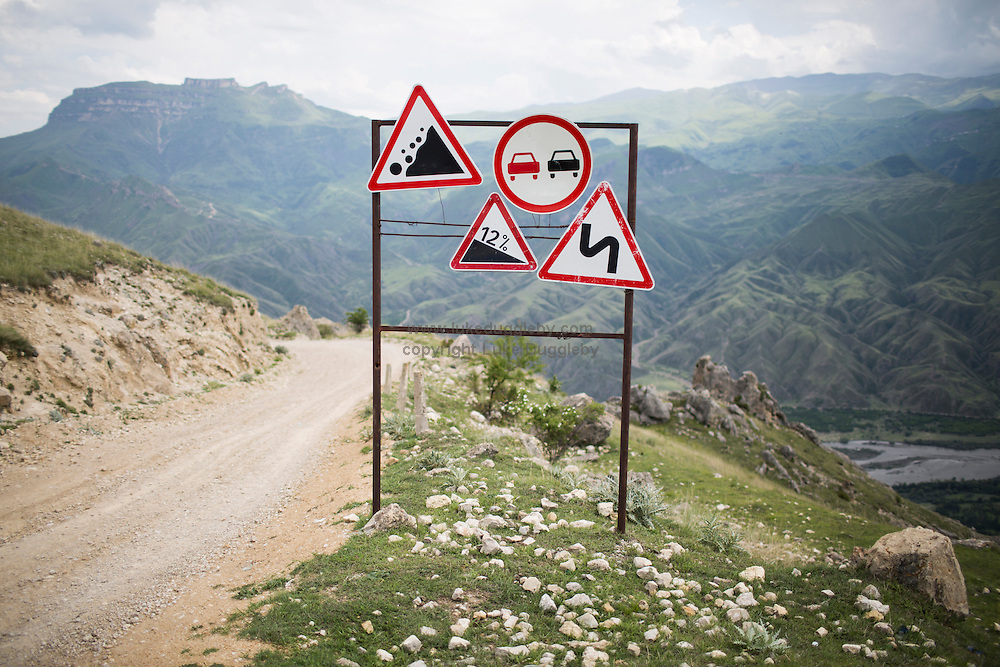 Various signs warning drivers of the dangers that lay a head on a remote mountain road.<br /> <br /> Located in the North Caucasus, bordering the Caspian Sea and a Republic of Russia, Dagestan is home to almost 3 million mostly muslim people. Ethnically very diverse, it is made up of several dozen ethnic groups and is Russia's most heterogeneous republic, where no ethnicity forms a majority.<br /> <br /> From 2000 until late 2012 Dagestan was subject to a violent Islamic separatist movement that spilled over from neighbouring Chechnya but has now been largely controlled by the Russian Government.<br /> <br /> Now relatively peaceful Dagestan (which means Land of Mountains) remains one of Russia's untouched treasures receiving few visitors. Due to its relative isolation, this beautiful mountainous region has maintained its traditional cultures that have been lost in many other parts of Russia.