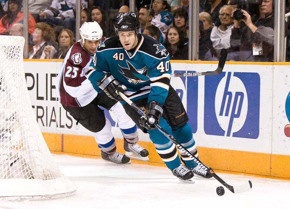 March 28, 2010; San Jose, CA, USA; San Jose Sharks defenseman Kent Huskins (40) skates past Colorado Avalanche right wing Chris Stewart (25) during the third period at HP Pavilion. San Jose defeated Colorado 4-3. Mandatory Credit: Jason O. Watson / US PRESSWIRE