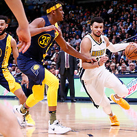 03 April 2018: Denver Nuggets guard Jamal Murray (27) drives past Indiana Pacers center Myles Turner (33) during the Denver Nuggets 107-104 victory over the Indiana Pacers, at the Pepsi Center, Denver, Colorado, USA.