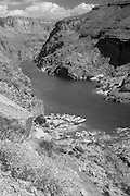View of the Colorado River and rafts from the top of Deer Creek Falls, Grand Canyon National Park, Arizona, US