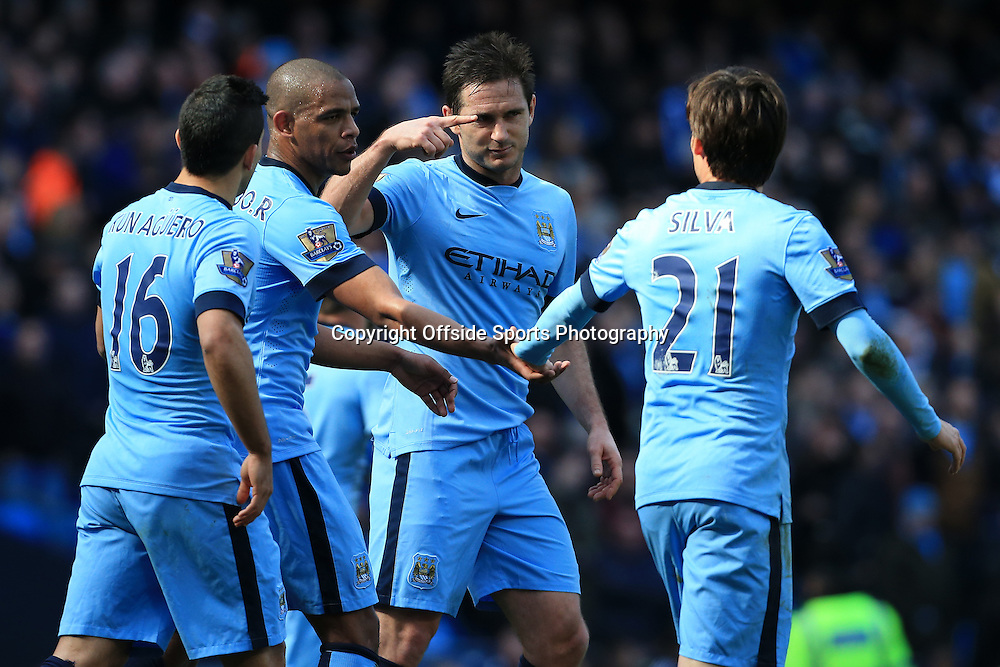 21st March 2015 - Barclays Premier League - Manchester City v West Bromwich Albion - Fernando of Man City (2L) celebrates with teammates, including Frank Lampard (2R) - Photo: Simon Stacpoole / Offside.