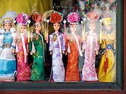 elegantly dressed souvenir Barbie dolls displayed in a window China