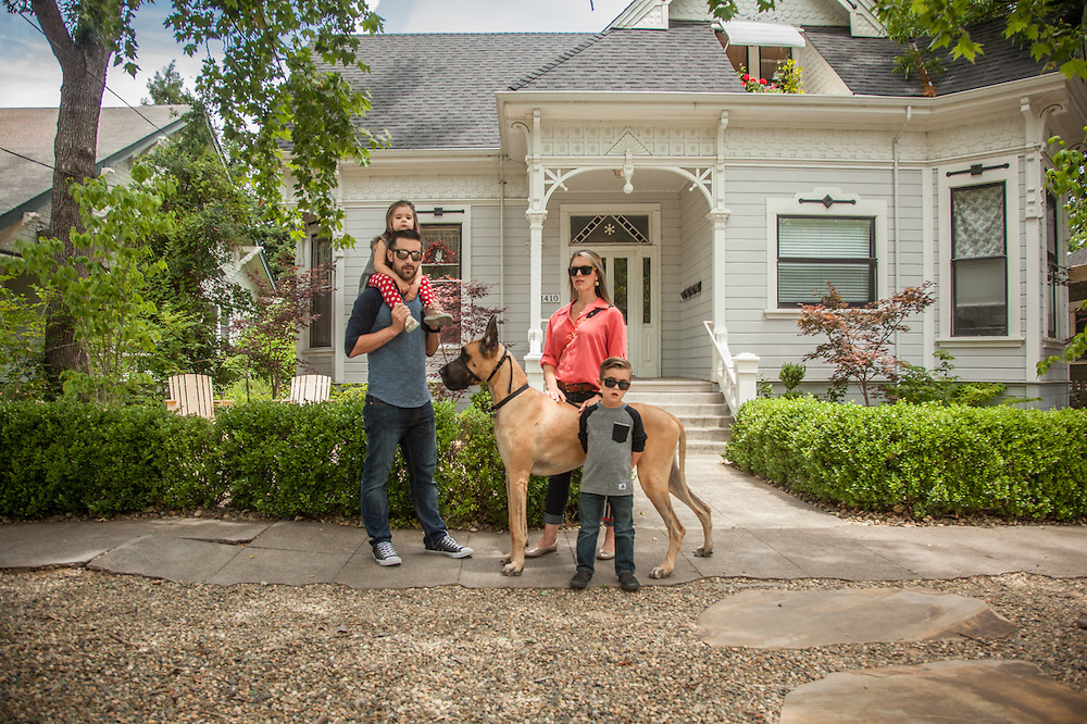 San Diego residents Jeff and Jodi Hickman take a walk down Cedar Street with their kids and Great Dane, Major.