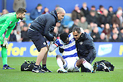 Queens Park Rangers forward Idrissa Sylla (40) being helped up after being injured during the EFL Sky Bet Championship match between Queens Park Rangers and Ipswich Town at the Loftus Road Stadium, London, England on 2 January 2017. Photo by Matthew Redman.