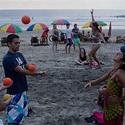 Beach performers on the shore in Montañita, Ecuador.