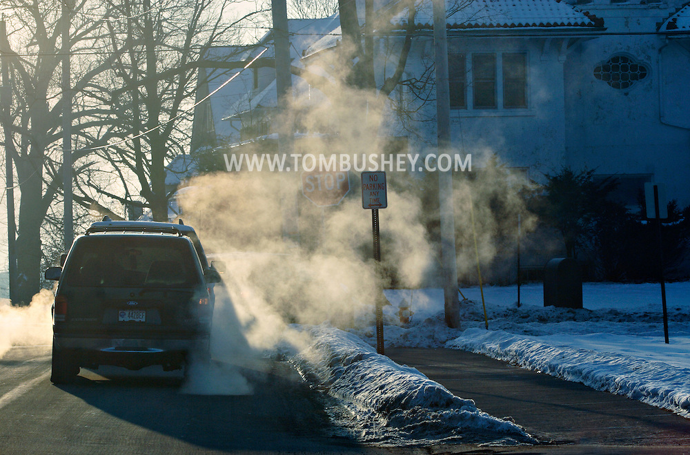 Middletown, NY - Exhaust from cars waiting at an intersection is visible on a cold, winter morning on Jan. 23, 2009.