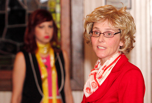 """Heather Atkinson as Blair Caterwaul (left) and Susan Robert as Barb Waters during Mayhem & Mystery's production of """"Newsworthy Nemesis"""" at the Spaghetti Warehouse in downtown Dayton, Friday, March 9, 2012."""