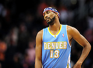 Nov. 12, 2012; Phoenix, AZ, USA; Denver Nuggets forward Corey Brewer (13) stands on the court in the game against the Phoenix Suns at US Airways Center. The Suns defeated the Nuggets 110-100. Mandatory Credit: Jennifer Stewart-USA TODAY Sports
