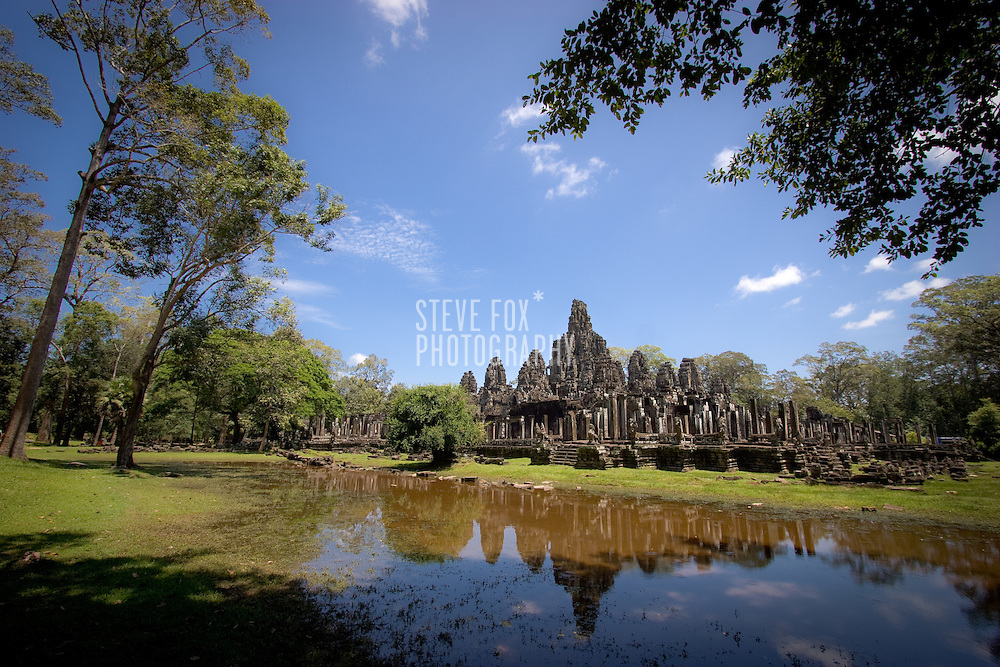 Bayon reflected in it's moat, Siem Reap, Cambodia