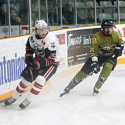 "TRENTON, ON  - MAY 4,  2017: Canadian Junior Hockey League, Central Canadian Jr. ""A"" Championship. The Dudley Hewitt Cup. Game 5 between Powassan Voodoos and the Georgetown Raiders. Jordan Anderson #25 of the Georgetown Raiders and  Ryan Bazzana #21 of the Powassan Voodoos skates after the puck during the first period.<br /> (Photo by Tim Bates / OJHL Images)"