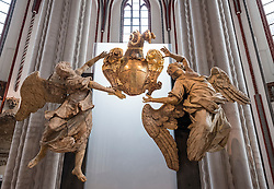 View of old stone cherub statues in Nikolaikirche, Nikolai Church, in historic Nikolaiviertel district in Mitte Berlin Germany