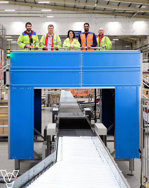 Royal Mail's Yorkshire Distribution Centre has got a new parcel scanning machine installed, part of a &pound;1.7m investment in distribution centres, which helps increase the number of parcels scanned in a day.  Pictured is the new parcel scanning machine at the Yorkshire Distribution Centre.  Pictured, from left, John Baxter, Richard Beck, Nina Bull, Arfan Ahmed and Chris Smith with the new parcel scanning machine at Yorkshire Distribution Centre.<br /> <br /> Picture: Chris Vaughan Photography<br /> Date: November 14, 2016