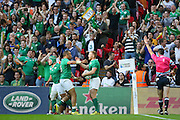 Ireland's Keith Earls is congratulated by Ireland's Simon Zebo after his try during the Rugby World Cup Pool D match between Ireland and Romania at Wembley Stadium, London, England on 27 September 2015. Photo by Phil Duncan.