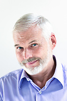 caucasian senior man portrait smiling isolated studio on white background