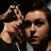 Stylist Emily Costello from Moko Salon performing on stage during scissor candy open chair 13 Sunday, Sept. 14, 2014 at National Mechanic in Philadelphia Pennsylvania.