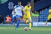 AFC Wimbledon midfielder Tom Beere (16) and Bury FC midfielder Jacob Mellis (18) during the The Emirates FA Cup 1st Round match between Bury and AFC Wimbledon at the JD Stadium, Bury, England on 5 November 2016. Photo by Stuart Butcher.