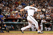 Aug 11, 2017; Phoenix, AZ, USA; Arizona Diamondbacks outfielder David Peralta (6) hits a two run home run in the fifth inning of the game against the Chicago Cubs at Chase Field. Mandatory Credit: Jennifer Stewart-USA TODAY Sports