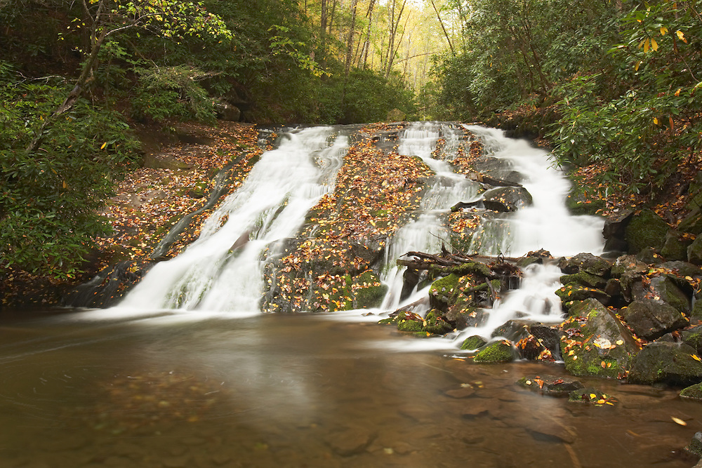 Scenic view of a stream in fall as it gently cascades over the top of Indian Creek Falls in Great Smoky Mountains National Park, N. Carolina. Afternoon.