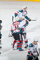 KELOWNA, CANADA - FEBRUARY 14: Josh Morrissey #27 congratulations brother Jake Morrissey #31 of Kelowna Rockets on the win and shut out against the Moose Jaw Warriors on February 14, 2015 at Prospera Place in Kelowna, British Columbia, Canada.  (Photo by Marissa Baecker/Shoot the Breeze)  *** Local Caption *** Josh Morrissey; Jake Morrissey;
