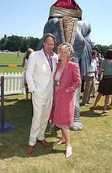 The EARL & COUNTESS OF MARCH at the Veuve Clicquot sponsored Gold Cup Final or the British Open Polo Championship held at Cowdray Park, West Sussex on 17th July 2005.<br />
