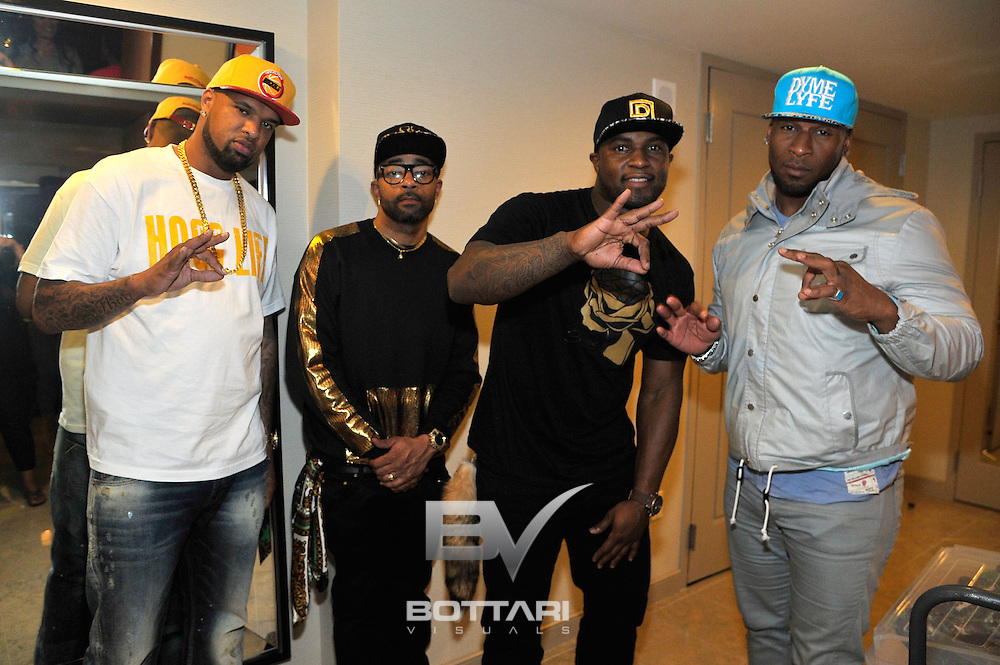 "LAS VEGAS, NV - FEBRUARY 19:  (L-R) Rapper ""Slim Thug"" Stayve Jerome Thomas, CEO of Flaucy Nate Willis, CEO of DYMELYFE DJ Williams and former NFL player Demetrin Veal, attend the FlauSachika Groups exclusive magic suite party at Aria Resort & Casino at CityCenter on February 19, 2013 in Las Vegas, Nevada.  (Photo by Jeff Bottari/WireImage)"