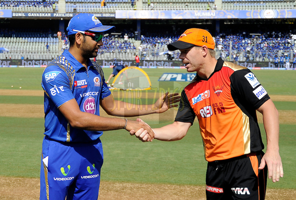 Rohit Sharma captain of Mumbai Indians and David Warner of Sunrisers Hyderabad during the toss before the start of the match 23 of the Pepsi IPL 2015 (Indian Premier League) between The Mumbai Indians and The Sunrisers Hyferabad held at the Wankhede Stadium in Mumbai India on the 25th April 2015.<br /> <br /> Photo by:  Pal Pillai / SPORTZPICS / IPL