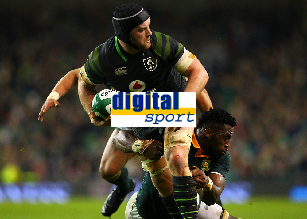 Rugby Union - 2017 Guinness Series (Autumn Internationals) - Ireland vs. South Africa<br /> <br /> Ireland's Sean O'Brien is tackled by South Africa's Siya Kolisi, at the Aviva Stadium.<br /> <br /> COLORSPORT/KEN SUTTON