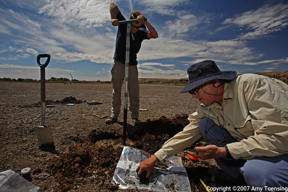 MURRAY BRIDGE, SA, AUSTRALIA - FEBRUARY 2: CSIRO Scientists, Rob Fitzpatrick and Paul Shand take soil samples in Paiwalla Wetland February 2, 2008 in Murray Bridge, South Australia, Australia. Located along the Murray River, Paiwalla Wetland had its water supply cut off during the drought. When it dried up, its bed turned sulfuric acid when highly concentrated, saline nutrients were exposed to oxygen. This is a widespread problem in the bottom end of the Murray-Darling Basin, where bodies of water that were made permanent by the irrigation system have dried up since the drought. The Murray-Darling Basin of Australia has been plagued with severe drought since the late 1990's and many growers and policy makers are being forced to work on implementing more efficient irrigation systems. (Photo by Amy Toensing/Reportage by Getty Images). _________________________________<br /> <br /> For stock or print inquires, please email us at studio@moyer-toensing.com.