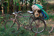 Water pump carried on the back of a bicycle. Village and Akagera river scenes, Kajevuba Village. Juru Sector. Bugesera district. Rwanda.<br /> <br /> &copy; Zute Lightfoot