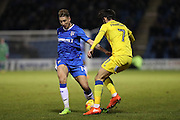 Gillingham FC midfielder Lee Martin (14) takes on AFC Wimbledon defender George Francomb (7) during the EFL Sky Bet League 1 match between Gillingham and AFC Wimbledon at the MEMS Priestfield Stadium, Gillingham, England on 21 February 2017.