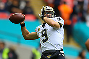 New Orleans Saints Quarterback Drew Brees (9) warms up during the Miami Dolphins vs New Orleans Saints International series match at Wembley Stadium, London, England on 1 October 2017. Photo by Jason Brown.