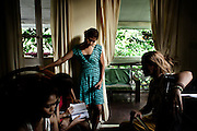 "YANGON, MYANMAR, MARCH 2012: The band working on the weekly schedule with their manager Nicole May.<br /> Burma is a country in Transition. And if that hasn't been made clear enough by the political debates and the recent by-elections, meet the Me N Ma Girls, the first girlband in the country.<br /> The timing couldn't be better. After the April 1st elections in 2012 an always increasing number of investors from all over the world has been visiting Myanmar. After decades of military regime and isolation, the strings of censorship have started loosening up. The government censors in fact for years have banned songs and articles, deleting anything that was seen as ""to provocative"" such as leather outfits and colored wigs.<br /> Describing themselves as Myanmar's first all-girl group, under the management of the Australian dancer and choreographer Nicole May, these five women - coming from either Buddhist or Catholic background and formerly known as Tiger Girls - not only have been challenging censorship laws but they're as well trying to win hearts in a society that in many ways remains man-dominated and socially conservative.<br /> In a country that has been locked up for years, the Me N Ma Girls, embracing western pop culture with skimpy outfits and catchy songs, show with every performance the will of the Burmese youth to come out of a decades-long isolation.<br /> Five girls leading a new form of rebellion: the kind that questions roles and cultural norms."