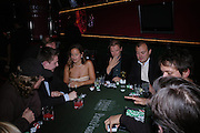 Jade Jagger and Hugo Guinness. PARTYPOKER.COM masterclass hosted by poker author Tony Holden. Ultra Lounge, Selfridges. 11 May 2005. ONE TIME USE ONLY - DO NOT ARCHIVE  © Copyright Photograph by Dafydd Jones 66 Stockwell Park Rd. London SW9 0DA Tel 020 7733 0108 www.dafjones.com