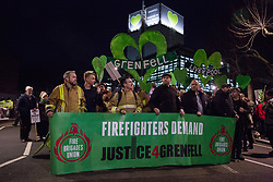London, UK. 14th February, 2019. Firefighters prepare to take part in the Grenfell Silent Walk around North Kensington with the Grenfell community on the monthly anniversary of the fire on 14th June 2017. 72 people died in the Grenfell Tower fire and over 70 were injured.