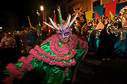 Costumed revelers called vejigantes dances in the streets during the Carnaval de Ponce February 21, 2009 in Ponce, Puerto Rico. Vejigantes are a folkloric character representing the devil.