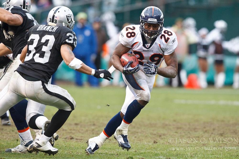 December 19, 2010; Oakland, CA, USA;  Denver Broncos running back Correll Buckhalter (28) rushes towards Oakland Raiders safety Tyvon Branch (33) during the third quarter at Oakland-Alameda County Coliseum. Oakland defeated Denver 39-23.