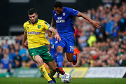 Norwich City defender Grant Hanley (31) makes a tackle Cardiff City midfielder Nathaniel Mendez-Laing (19) during the EFL Sky Bet Championship match between Norwich City and Cardiff City at Carrow Road, Norwich, England on 14 April 2018. Picture by Phil Chaplin.