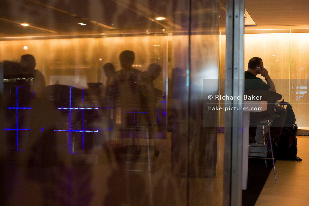 Club Class passengers enjoying luxurious facilities at the British Airways Galleries Club lounge at Heathrow Airport's T5