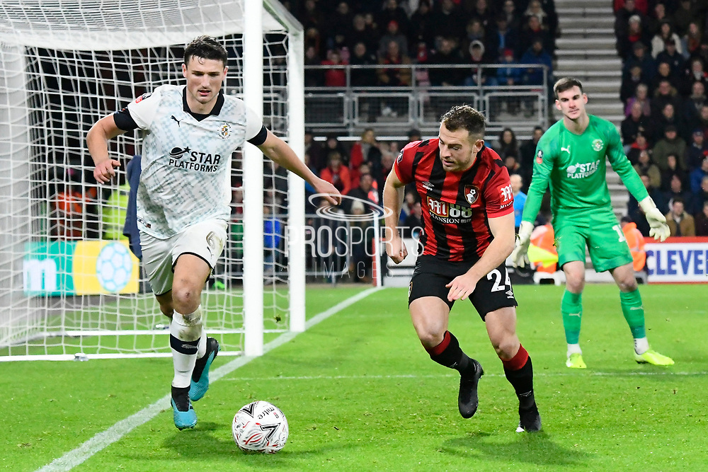Matty Pearson (6) of Luton Town battles for possession with Ryan Fraser (24) of AFC Bournemouth during the The FA Cup match between Bournemouth and Luton Town at the Vitality Stadium, Bournemouth, England on 4 January 2020.