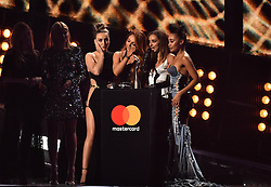 Little Mix's Perrie Edwards, Jesy Nelson, Leigh-Anne Pinnock and Jade Thirlwall with the award for Best British Single on stage at the BRIT Awards 2017, held at The O2 Arena, in London.<br />