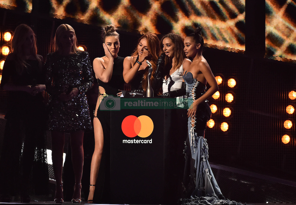 Little Mix's Perrie Edwards, Jesy Nelson, Leigh-Anne Pinnock and Jade Thirlwall with the award for Best British Single on stage at the BRIT Awards 2017, held at The O2 Arena, in London.<br /><br />Picture date Tuesday February 22, 2017. Picture credit should read Matt Crossick/ EMPICS Entertainment. Editorial Use Only - No Merchandise.