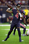 Houston Texans quarterback Deshaun Watson (4) throws a first quarter pass for a gain of 6 yards and a first down at the Texans 31 yard line during the NFL week 8 regular season football game against the Miami Dolphins on Thursday, Oct. 25, 2018 in Houston. The Texans won the game 42-23. (©Paul Anthony Spinelli)