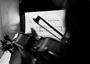 Kimi Samson plays violin Monday in Florence at practice for Dylan LeBlanc's shows. Samson, who has lived here since 2002, plays violin in studio and for a variety of bands in the Shoals.