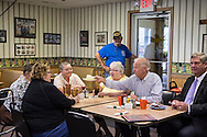 Vice President Joe Biden passes a slice of pie to a patron during an unannounced stop at the Good Earth Restaurant during a two-day campaign swing through Iowa on Monday, September 17, 2012 in Muscatine, IA.