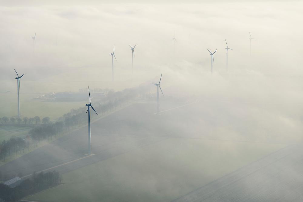 Nederland, Flevoland, Lelystad, 11-12-2013; Vogelweg, windmolens en boerderijen in de mist, omgeving Vliegveld Lelystad.<br /> Windmills and farms in the fog, environment of Lelystad Airport.<br /> luchtfoto (toeslag op standaard tarieven);<br /> aerial photo (additional fee required);<br /> copyright foto/photo Siebe Swart.