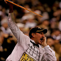 2009 December 19: A New Orleans Saints fan in the stands cheers during a 24-17 win by the Dallas Cowboys over the New Orleans Saints at the Louisiana Superdome in New Orleans, Louisiana.