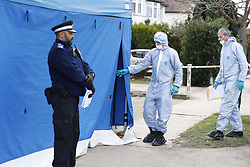 © Licensed to London News Pictures. 14/03/2018. London, UK. Police in protective clothing cover windows at the house of Russian exile Nikolai Glushkov in south west London. Mr Glushkov, a friend of oligarch Boris Berezovsky, and a former deputy director of Russian state airline Aeroflot, died at his home in Monday night. Police continue to investigate. Photo credit: Peter Macdiarmid/LNP