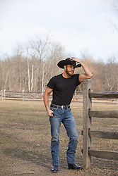 cowboy relaxing on a ranch